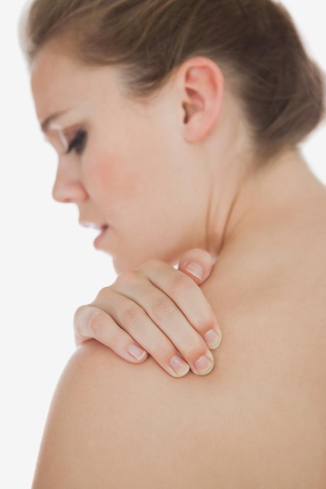 """""""Upset woman suffering from shoulder pain"""" stock image"""