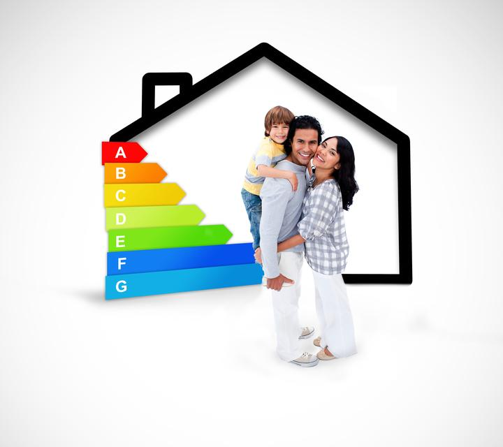 """""""Smiling family standing with a black house illustration with energy rating"""" stock image"""