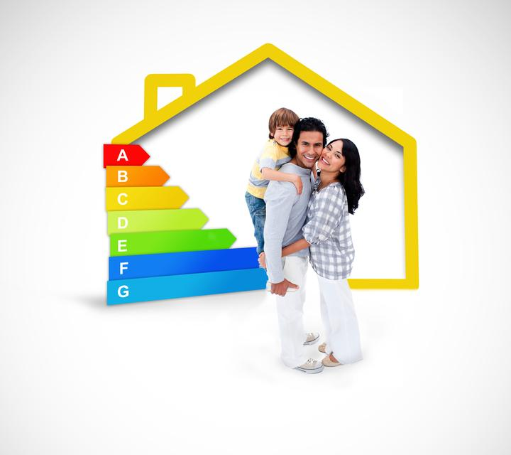"""""""Smiling family standing with a yellow house illustration with energy rating"""" stock image"""
