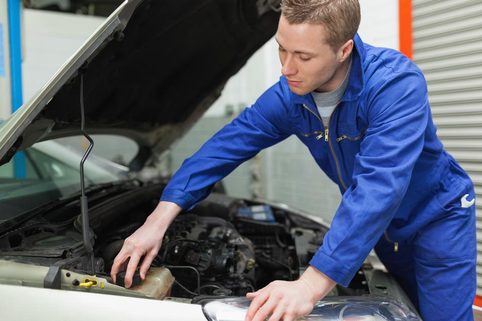 """""""Mechanic closing the lid of windshield washer tank"""" stock image"""