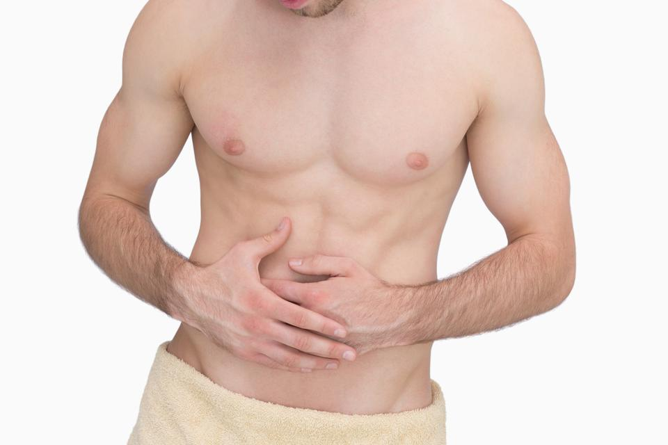 """Midsection of man with stomach ache"" stock image"