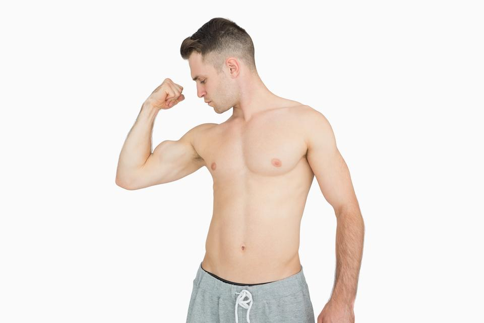 """""""Shirtless young man flexing muscles"""" stock image"""
