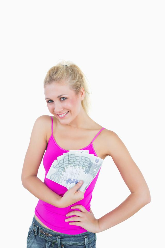 """""""Portrait of happy young woman holding fanned euro banknotes"""" stock image"""