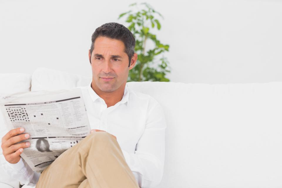 """Serious man reading a news paper"" stock image"