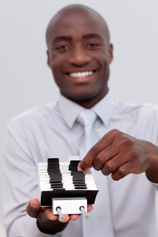 """""""Businessman looking at an index holder"""" stock image"""