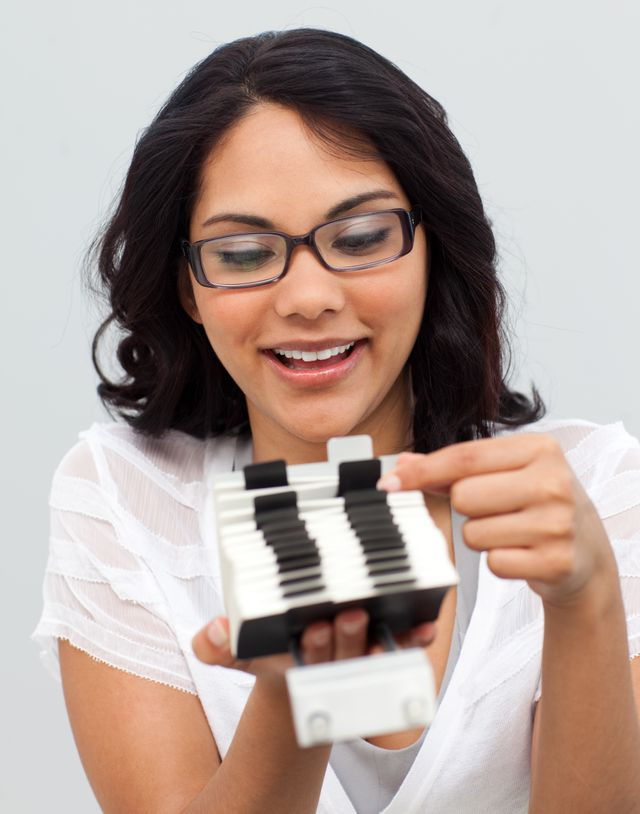 """""""Businesswoman searching for an index"""" stock image"""