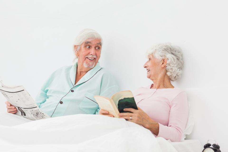 """Happy couple chatting and reading"" stock image"