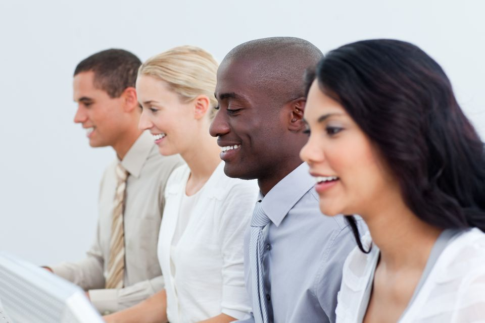 """""""Presentation of a diverse business team at work"""" stock image"""