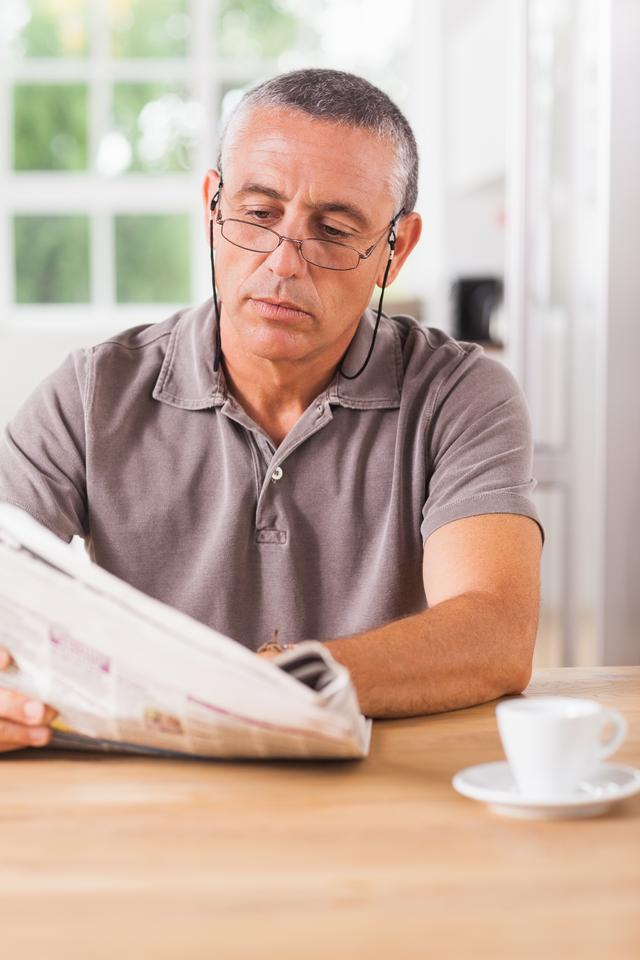 """Man reading newspaper"" stock image"