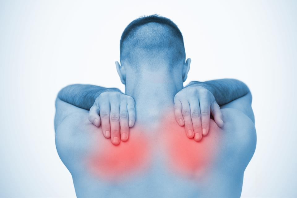"""Man touching highlighted sore shoulders"" stock image"