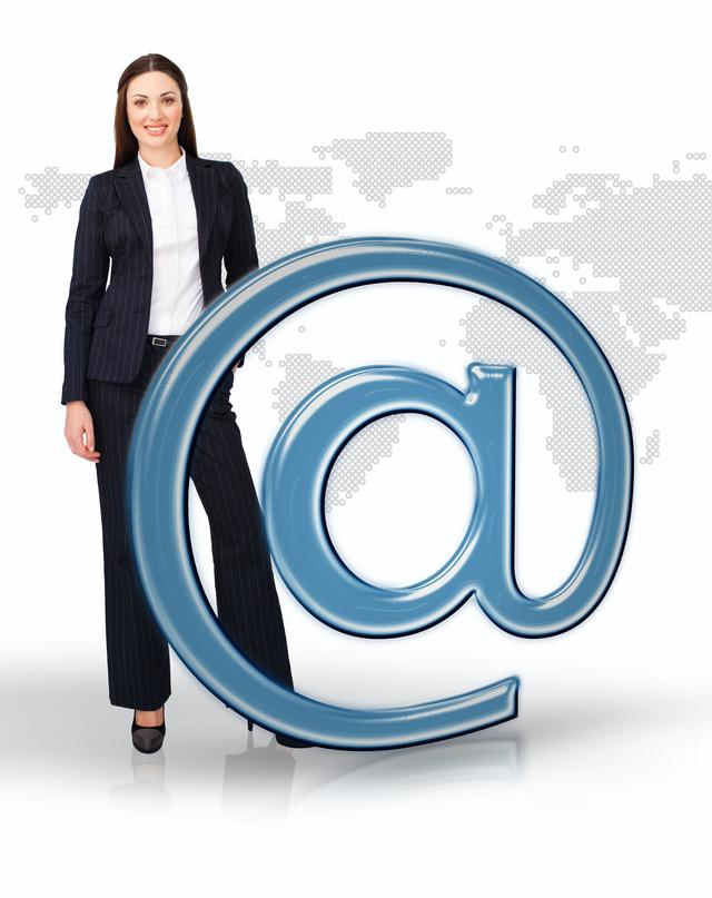 """Businesswoman standing by email at symbol"" stock image"
