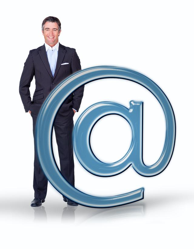 """Businessman standing with email at symbol"" stock image"