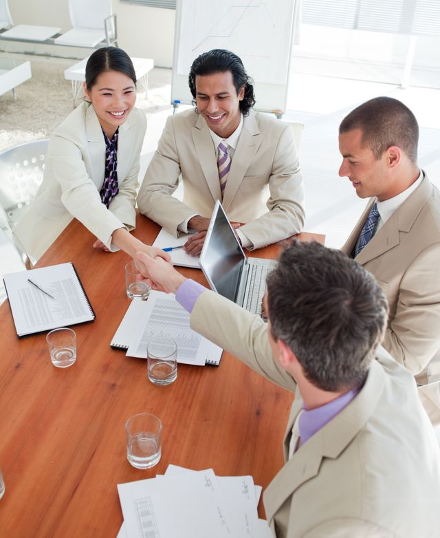 """""""Cheerful Business associates closing a deal"""" stock image"""
