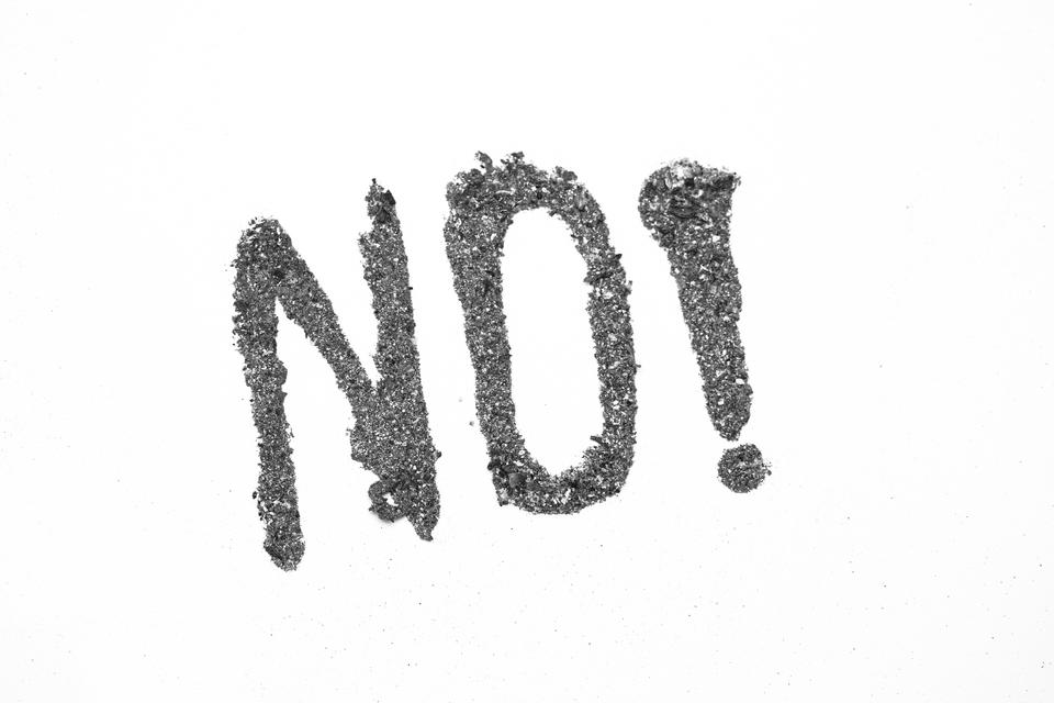 """""""No with exclamation mark spelled out in ash"""" stock image"""