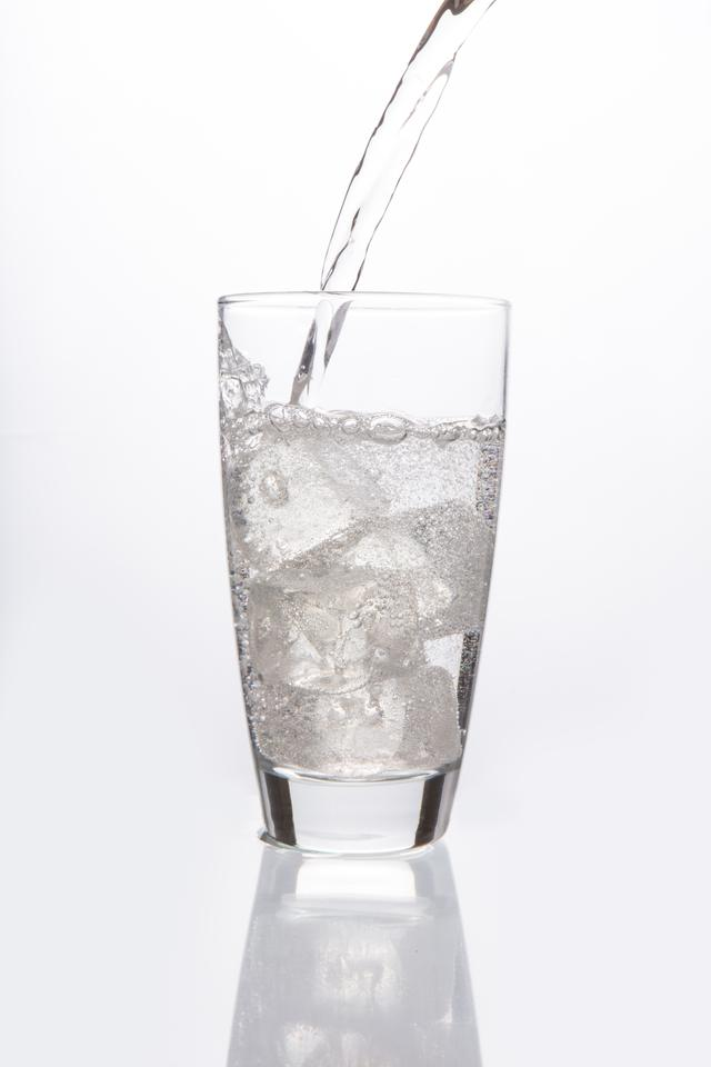 """""""Sparkling water pouring into glass"""" stock image"""