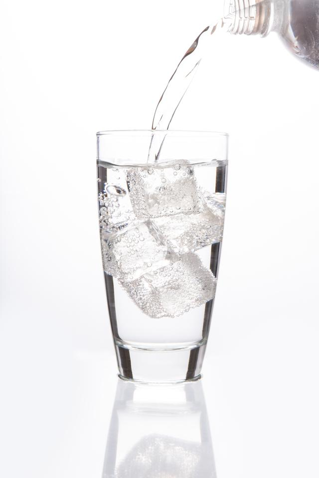 """""""Sparkling water filling glass"""" stock image"""