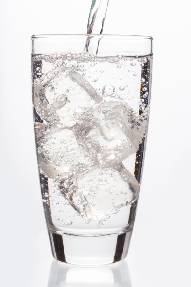 """""""Close up on sparkling water filling a glass"""" stock image"""