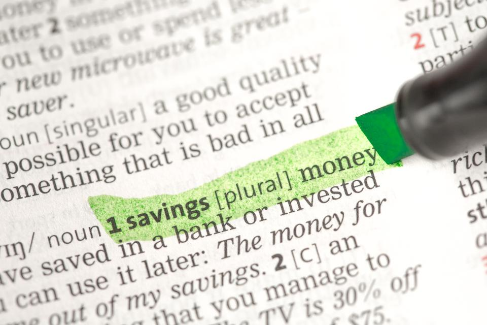 """""""Savings money definition highlighted in green"""" stock image"""