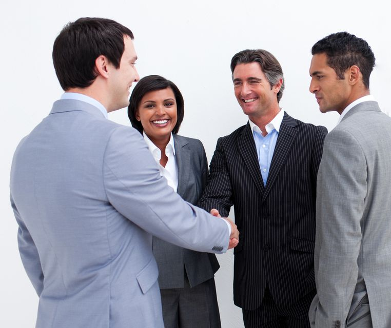 """""""International business people closing a deal"""" stock image"""