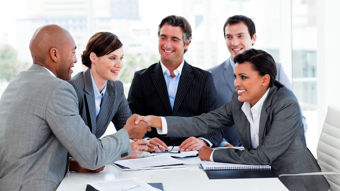 """""""Happy business people closing a deal"""" stock image"""