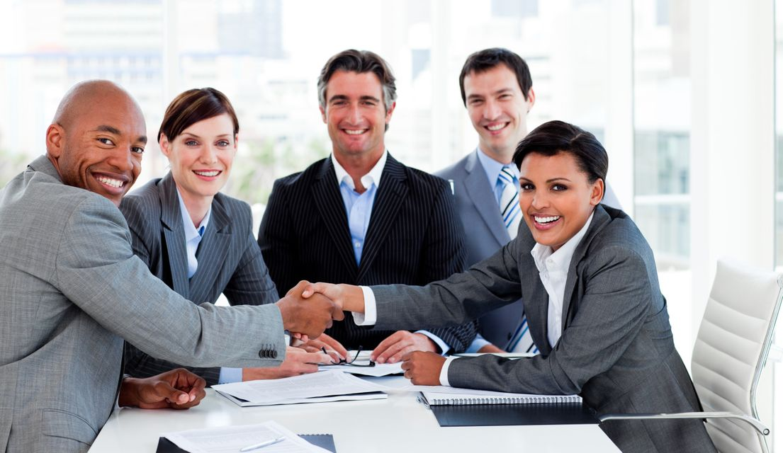 """""""A diverse business group closing a deal"""" stock image"""