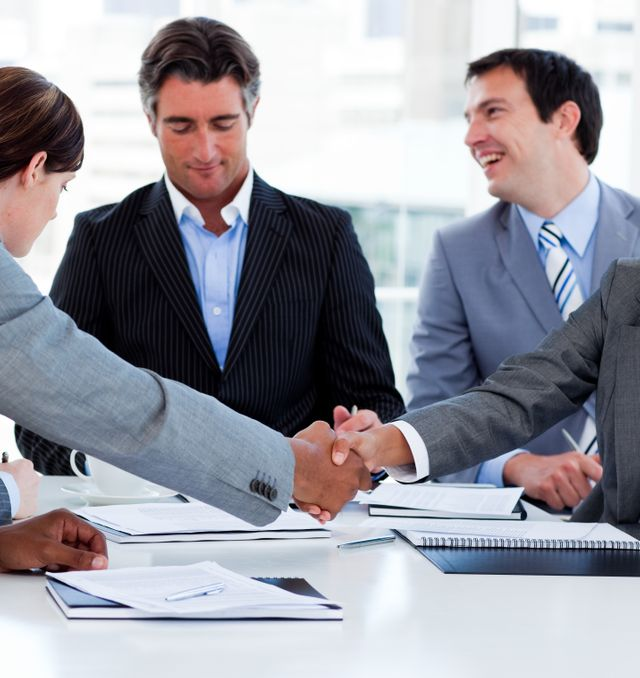 """""""Close up of successful business people closing a deal"""" stock image"""