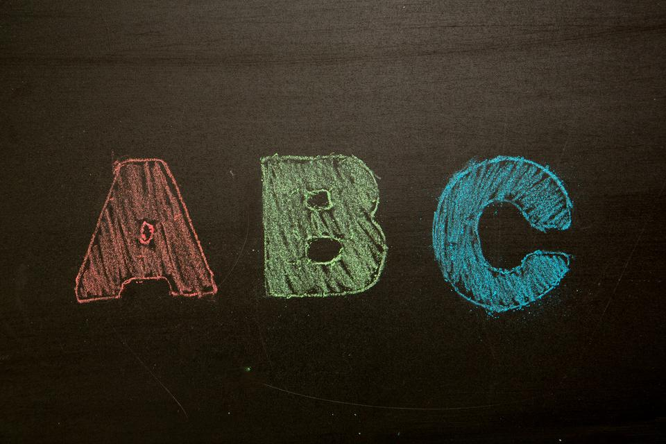"""Abc drawn and coloured in on blackboard"" stock image"