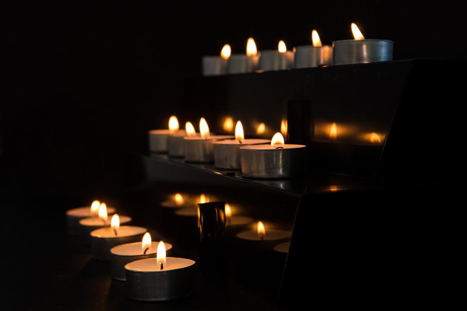 """""""Candles at the alter in the darkness"""" stock image"""