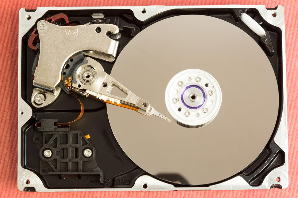 """Overhead of working disk drive"" stock image"