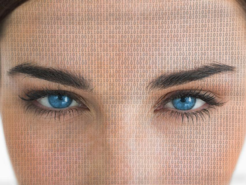 """""""Attractive blue eyed woman with binary coding on face"""" stock image"""
