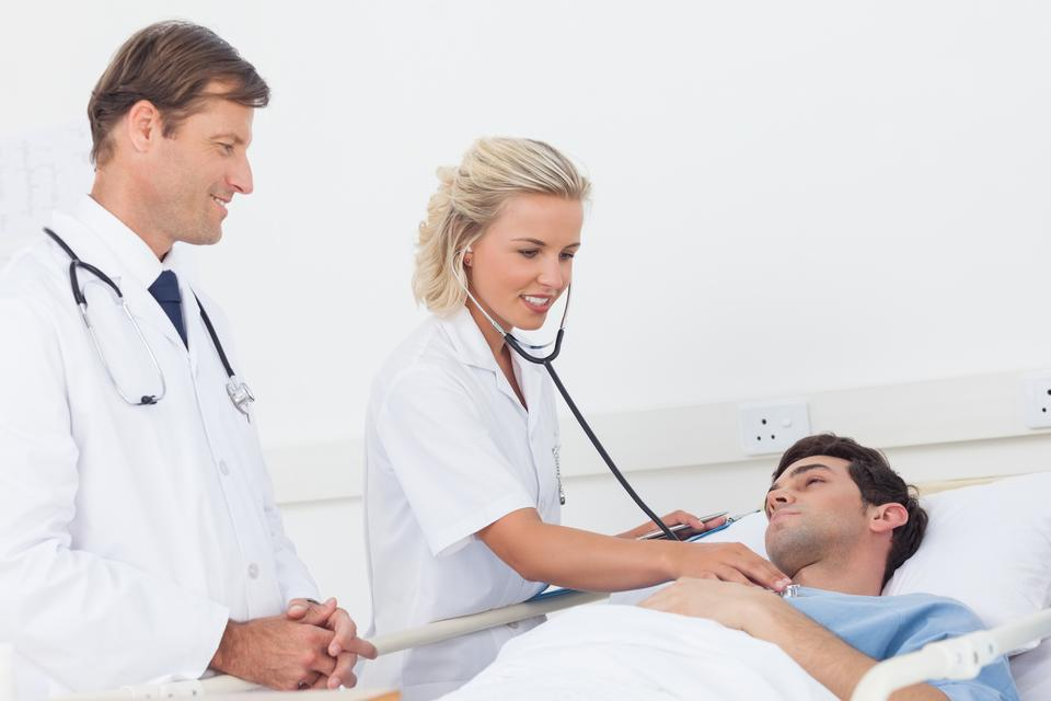 """Doctor taking the heartbeat of her patient"" stock image"