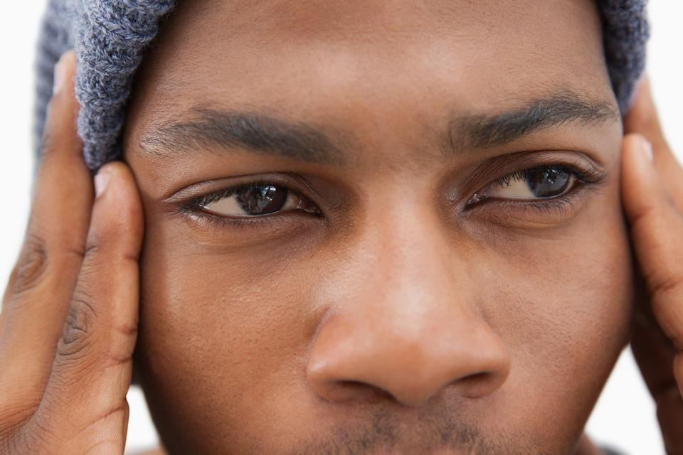 """Man in beanie hat looking upset"" stock image"