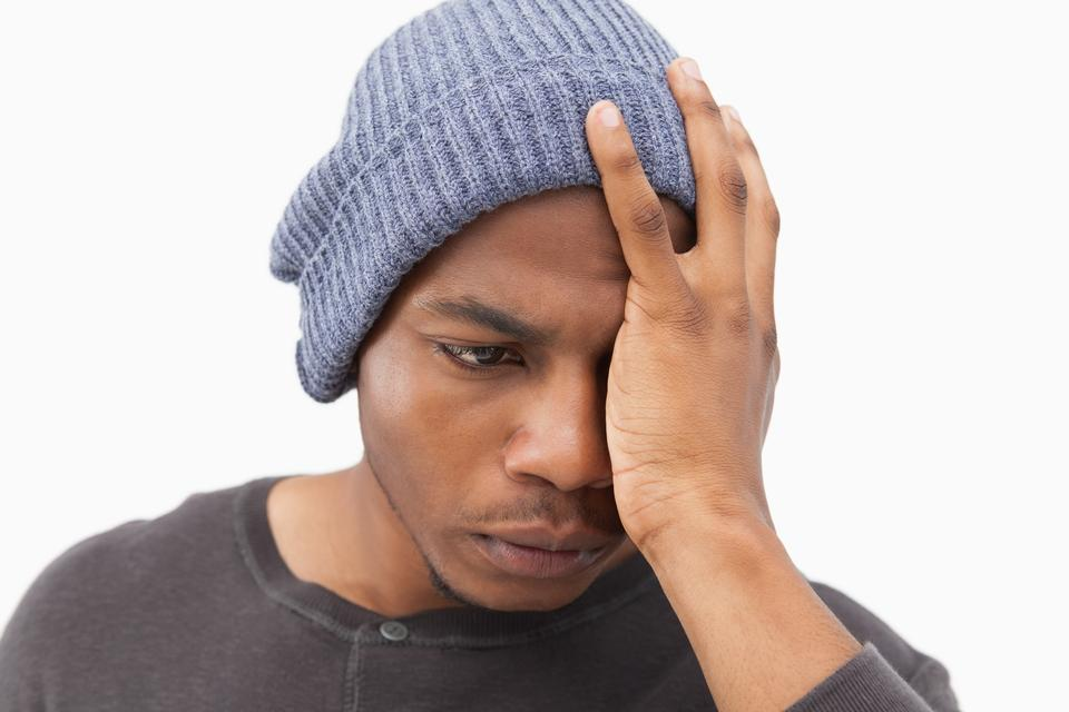 """Depressed man in beanie hat"" stock image"