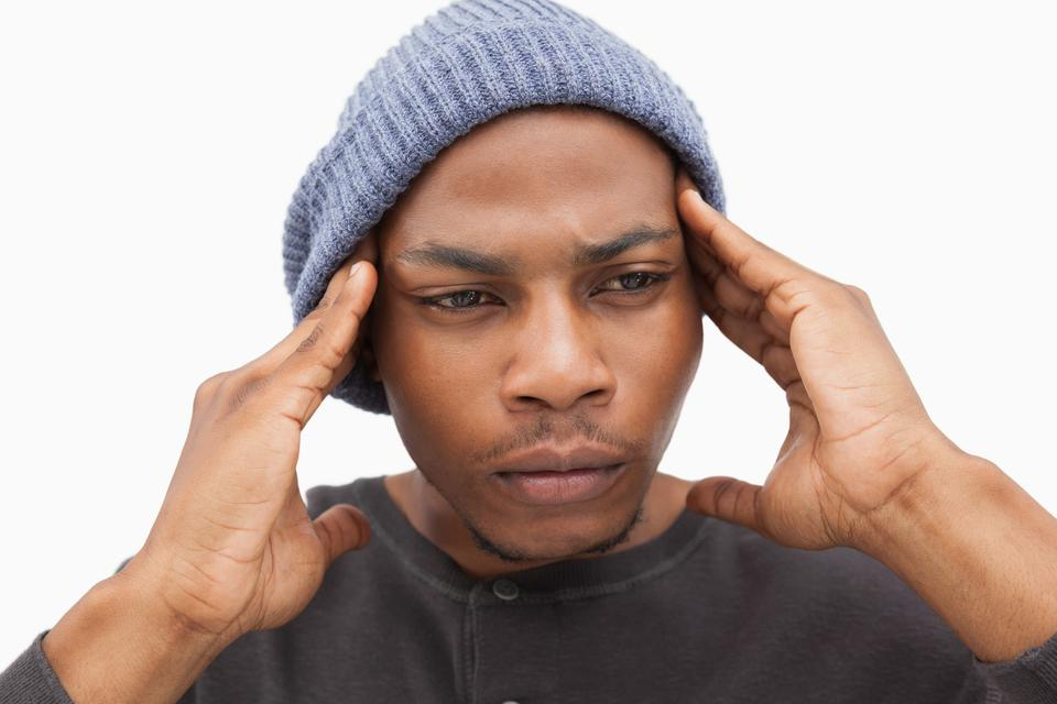 """Worried man in beanie hat"" stock image"