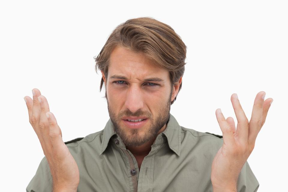 """Irritated man gestuing at camera"" stock image"