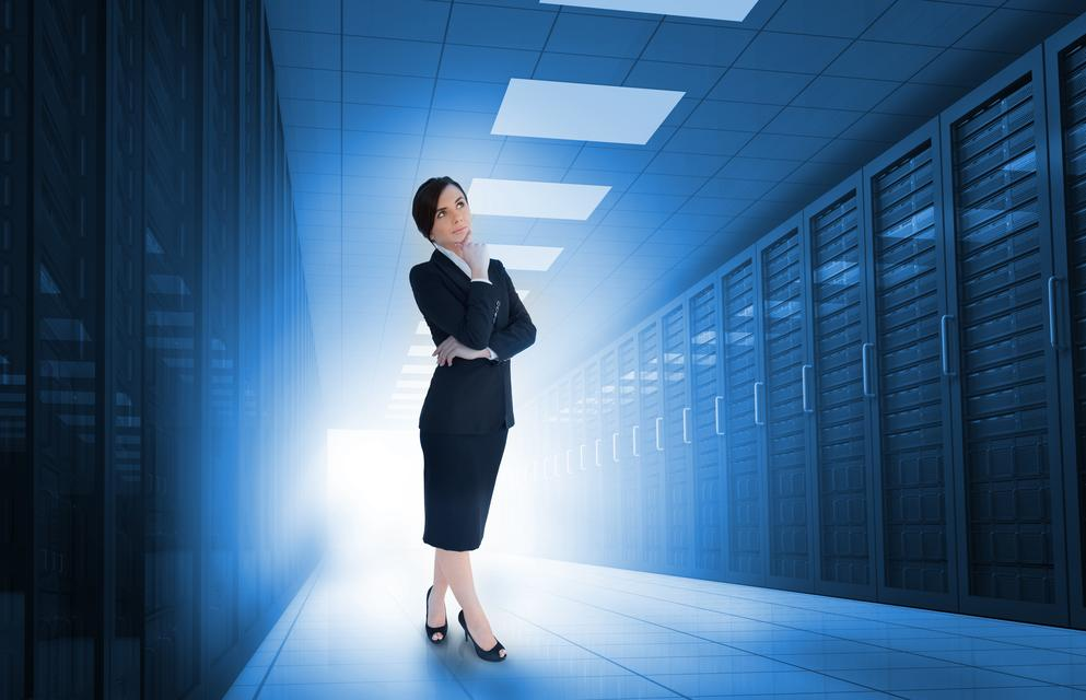 """Businesswoman standing in data center"" stock image"
