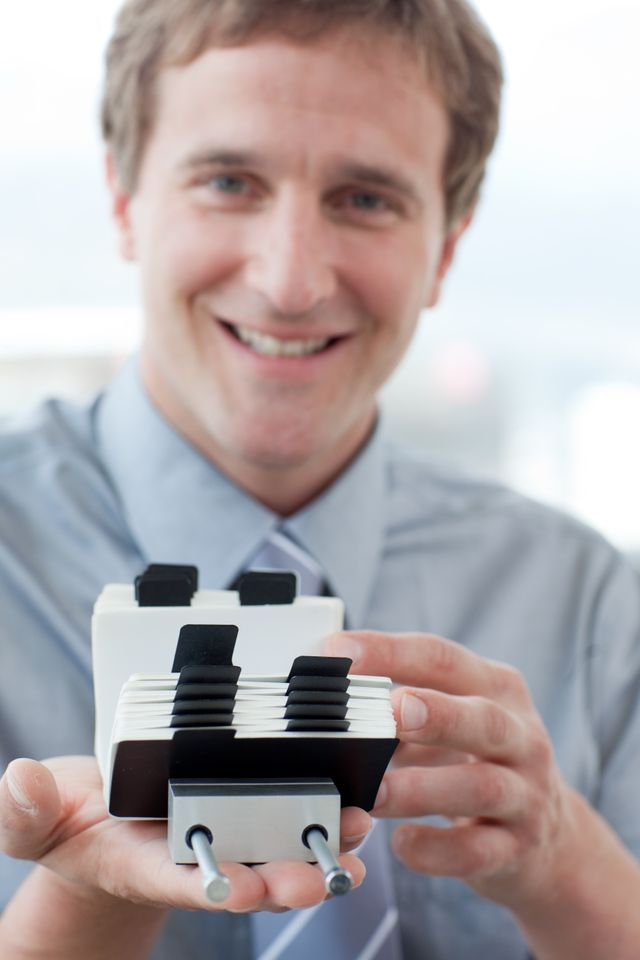 """""""Young businessman searching for the index"""" stock image"""