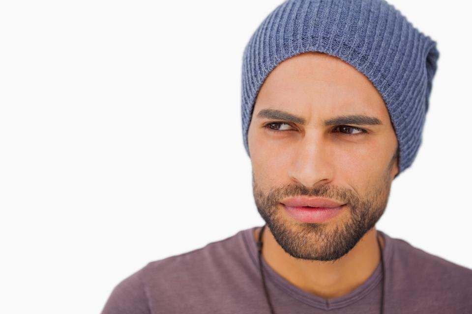 """Thoughtful man wearing beanie hat"" stock image"