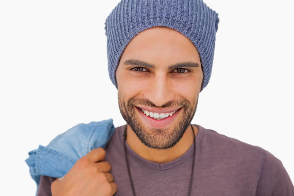 """Smiling man wearing beanie hat"" stock image"