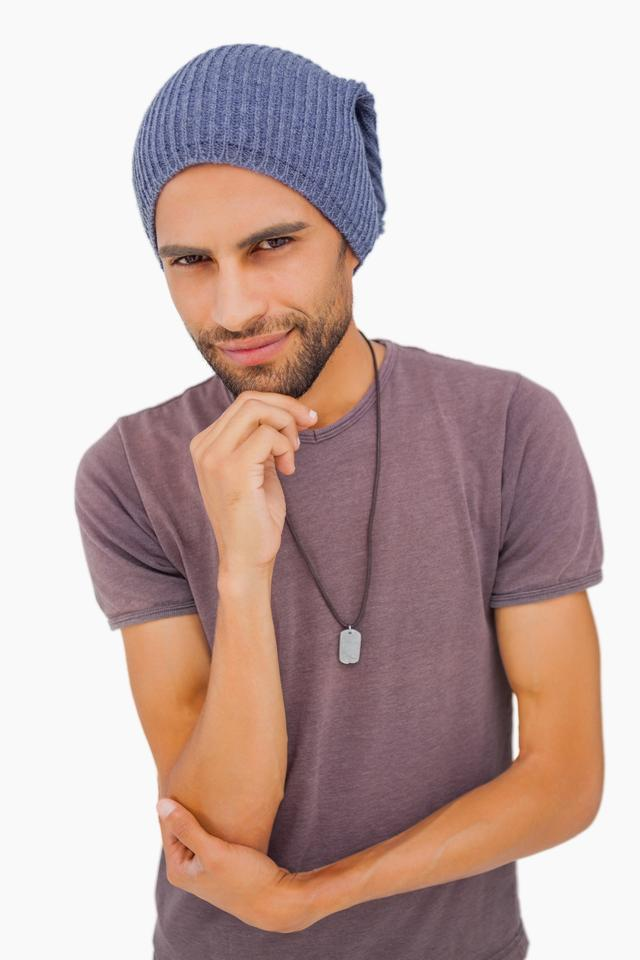 """Thinking man wearing beanie hat"" stock image"