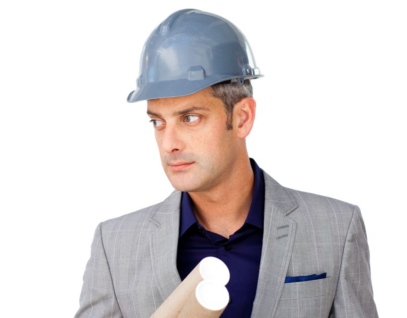 """Serious male architect wearing a hardhat"" stock image"