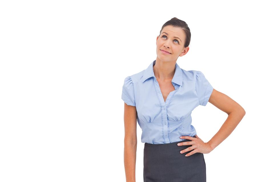 """Businesswoman thinking with hand on hip"" stock image"