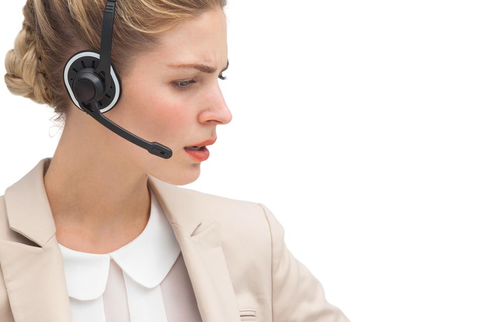 """""""Annoyed call center agent"""" stock image"""
