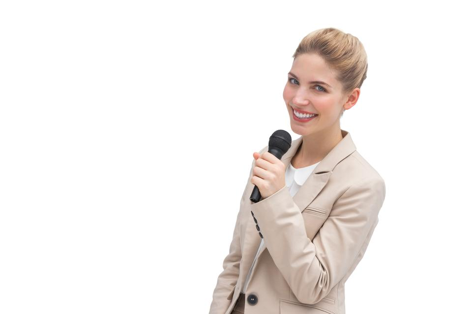 """Well dressed woman with microphone"" stock image"
