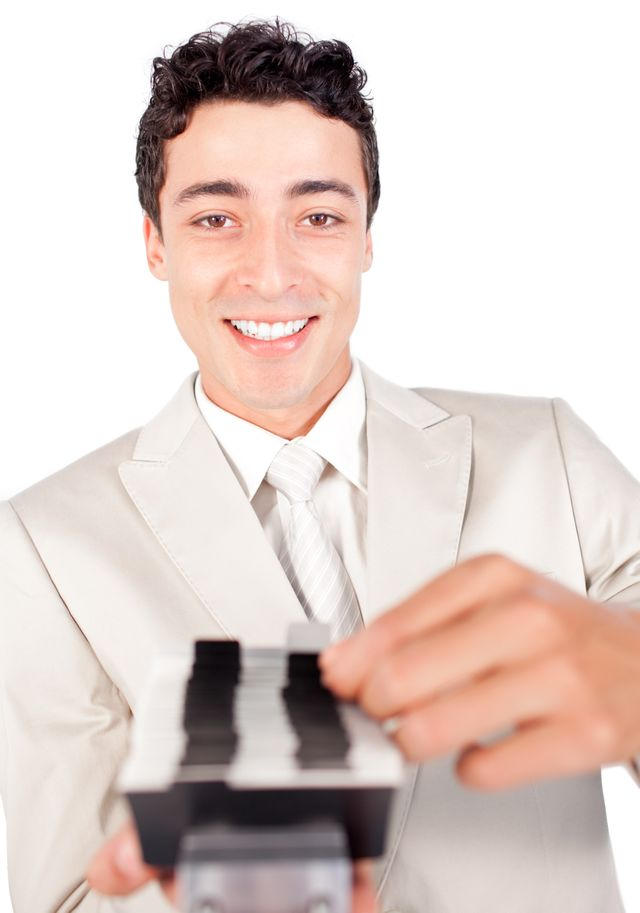 """""""Smiling businessman searching for the index"""" stock image"""