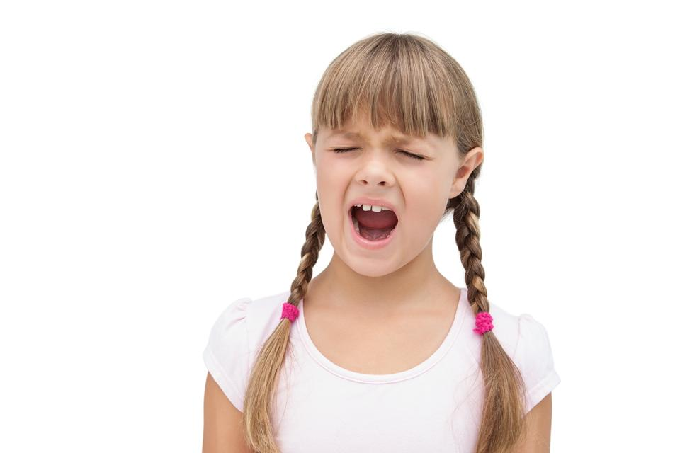 """""""Furious little girl with eyes closed"""" stock image"""