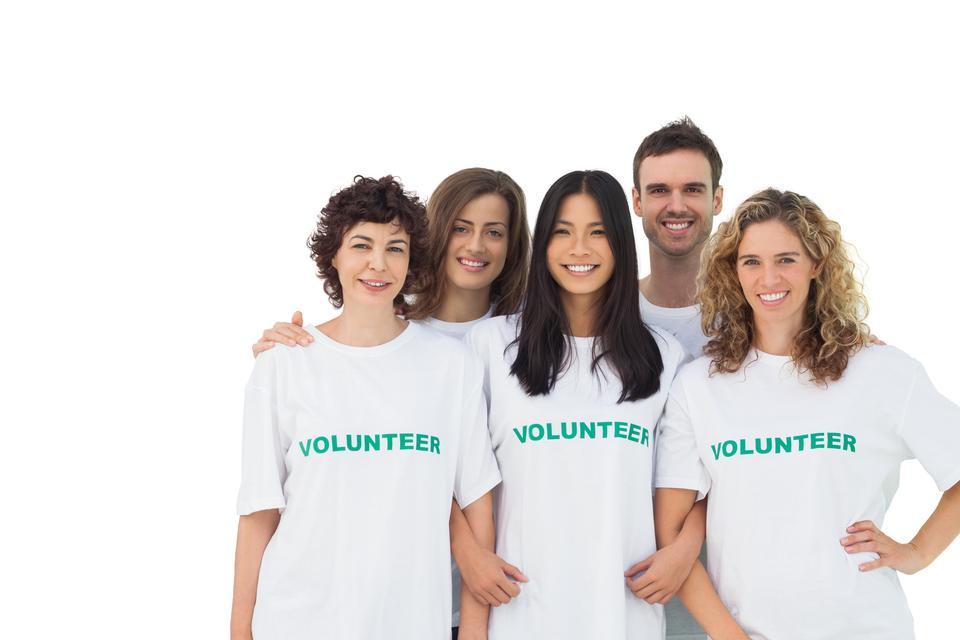 """Smiling group of volunteers standing"" stock image"