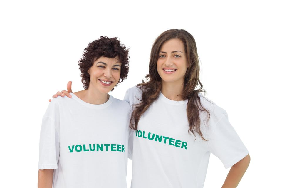 """Two cheerful volunteers standing"" stock image"