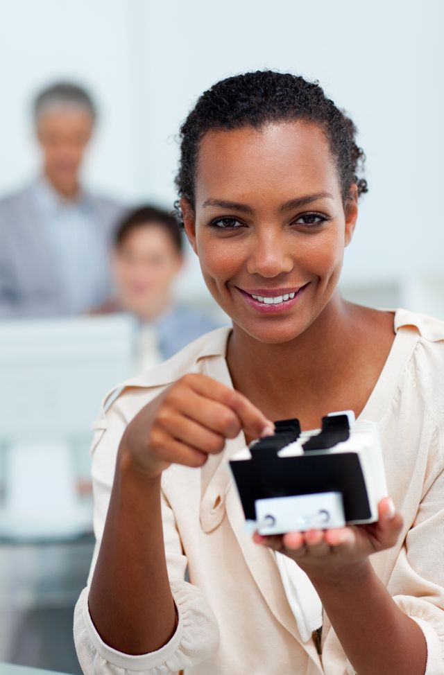 """""""Cheerful busineswoman searching for the index"""" stock image"""
