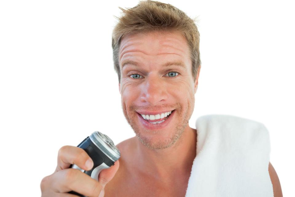 """""""Handsome man holding an electric razor"""" stock image"""